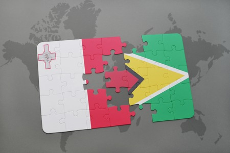 guyanese: puzzle with the national flag of malta and guyana on a world map background. 3D illustration
