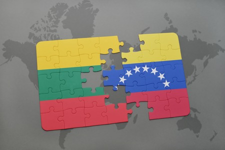puzzle with the national flag of lithuania and venezuela on a world map background. 3D illustration Фото со стока