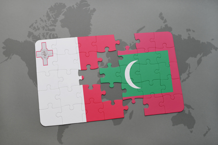 puzzle with the national flag of malta and maldives on a world map background. 3D illustration Stock Photo