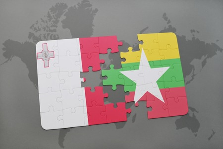 puzzle with the national flag of malta and myanmar on a world map background. 3D illustration