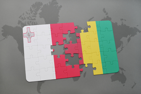 puzzle with the national flag of malta and guinea on a world map background. 3D illustration Stock Photo
