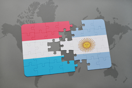 aires: puzzle with the national flag of luxembourg and argentina on a world map background. 3D illustration
