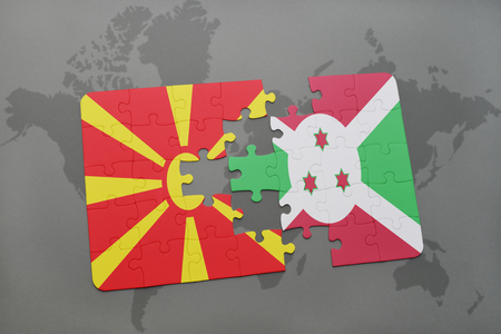 puzzle with the national flag of macedonia and burundi on a world map background. 3D illustration