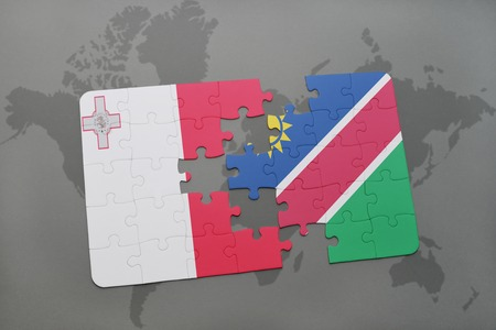 puzzle with the national flag of malta and namibia on a world map background. 3D illustration