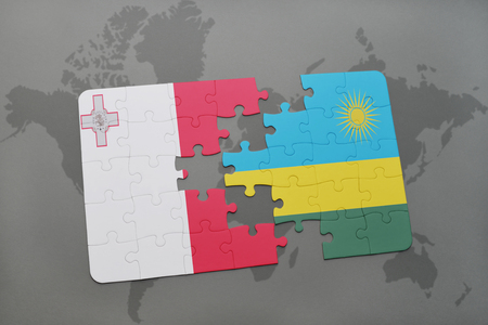 puzzle with the national flag of malta and rwanda on a world map background. 3D illustration Stock Photo