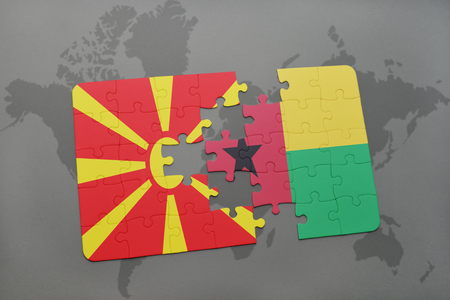 puzzle with the national flag of macedonia and guinea bissau on a world map background. 3D illustration Stock Photo
