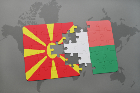 puzzle with the national flag of macedonia and madagascar on a world map background. 3D illustration Stock Photo