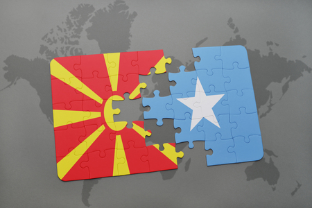 puzzle with the national flag of macedonia and somalia on a world map background. 3D illustration Stock Photo