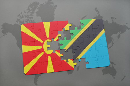 puzzle with the national flag of macedonia and tanzania on a world map background. 3D illustration Stock Photo