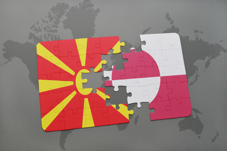 puzzle with the national flag of macedonia and greenland on a world map background. 3D illustration