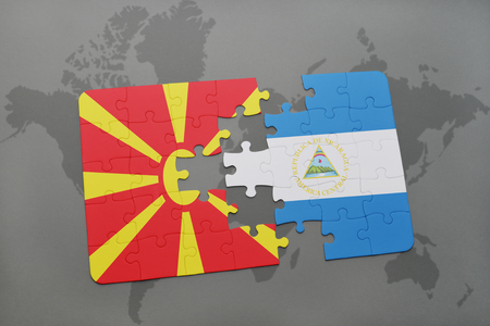 puzzle with the national flag of macedonia and nicaragua on a world map background. 3D illustration