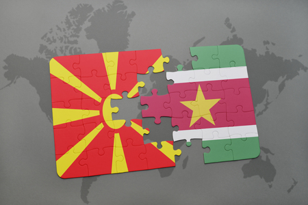 puzzle with the national flag of macedonia and suriname on a world map background. 3D illustration