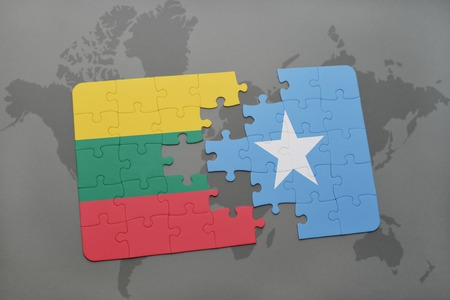puzzle with the national flag of lithuania and somalia on a world map background. 3D illustration