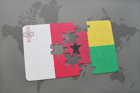 maltese map: puzzle with the national flag of malta and guinea bissau on a world map background. 3D illustration