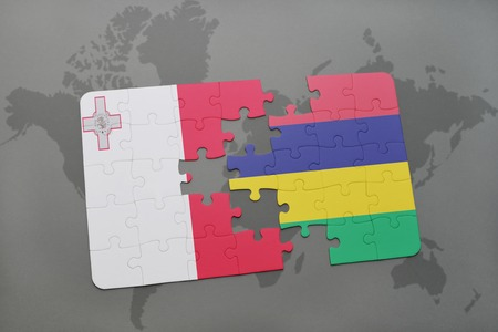 maltese map: puzzle with the national flag of malta and mauritius on a world map background. 3D illustration Stock Photo