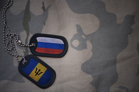 anti terrorist: army blank, dog tag with flag of russia and barbados on the khaki texture background. military concept