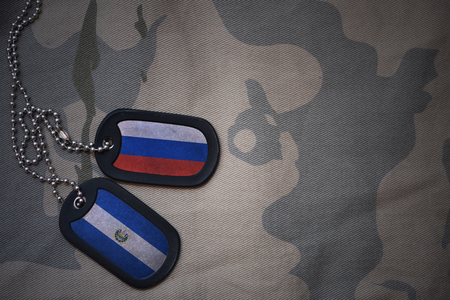 anti terrorist: army blank, dog tag with flag of russia and el salvador on the khaki texture background. military concept Stock Photo