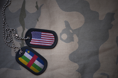 anti terrorist: army blank, dog tag with flag of united states of america and central african republic on the khaki texture background. military concept