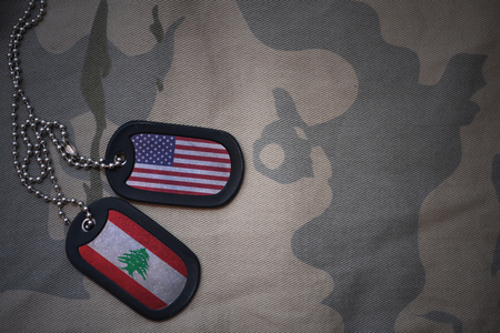 anti terrorist: army blank, dog tag with flag of united states of america and lebanon on the khaki texture background. military concept