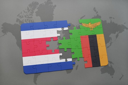 puzzle with the national flag of costa rica and zambia on a world map background. 3D illustration