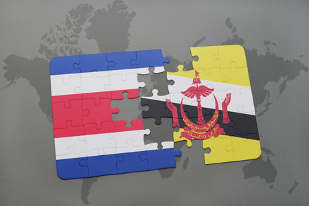puzzle with the national flag of costa rica and brunei on a world map background. 3D illustration Stock Photo