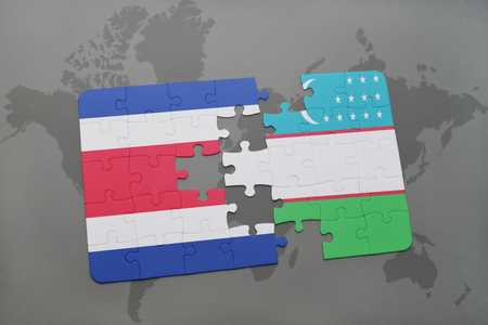 puzzle with the national flag of costa rica and uzbekistan on a world map background. 3D illustration