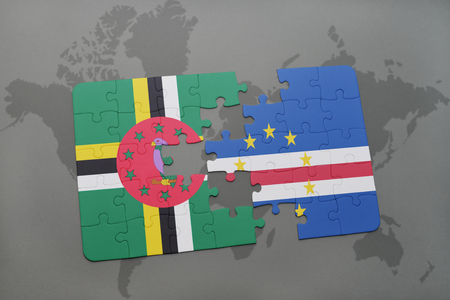 praia: puzzle with the national flag of dominica and cape verde on a world map background. 3D illustration