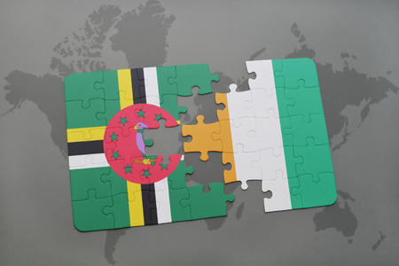 puzzle with the national flag of dominica and cote divoire on a world map background. 3D illustration Stock Photo