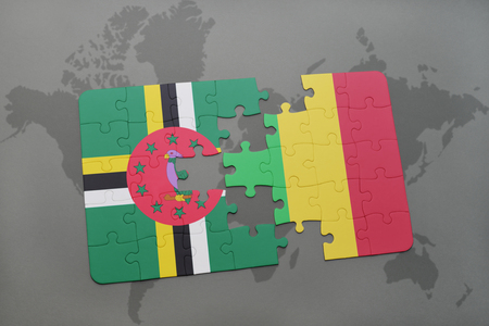 puzzle with the national flag of dominica and mali on a world map background. 3D illustration