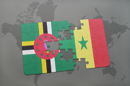 senegal: puzzle with the national flag of dominica and senegal on a world map background. 3D illustration