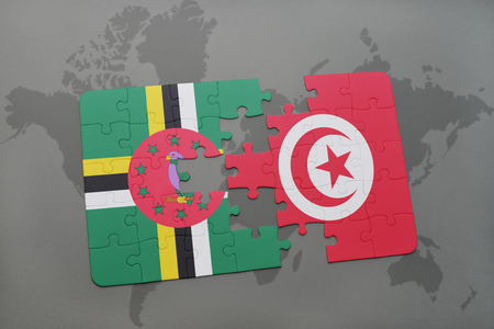 puzzle with the national flag of dominica and tunisia on a world map background. 3D illustration