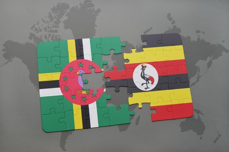 kampala: puzzle with the national flag of dominica and uganda on a world map background. 3D illustration