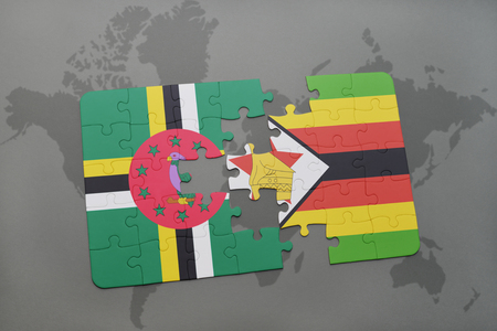 puzzle with the national flag of dominica and zimbabwe on a world map background. 3D illustration Stock Photo