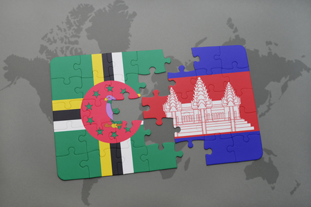 cambodian: puzzle with the national flag of dominica and cambodia on a world map background. 3D illustration Stock Photo