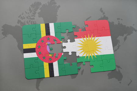 puzzle with the national flag of dominica and kurdistan on a world map background. 3D illustration