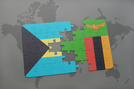 puzzle with the national flag of bahamas and zambia on a world map background. 3D illustration Stock Photo
