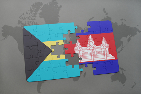 puzzle with the national flag of bahamas and cambodia on a world map background. 3D illustration