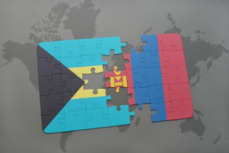 mongolia: puzzle with the national flag of bahamas and mongolia on a world map background. 3D illustration