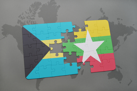 puzzle with the national flag of bahamas and myanmar on a world map background. 3D illustration Stock Illustration - 75998374