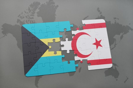 puzzle with the national flag of bahamas and northern cyprus on a world map background. 3D illustration