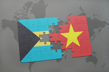 puzzle with the national flag of bahamas and vietnam on a world map background. 3D illustration Stock Photo
