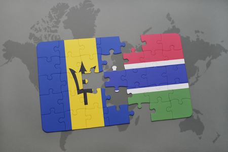 puzzle with the national flag of barbados and gambia on a world map background. 3D illustration Stock Photo