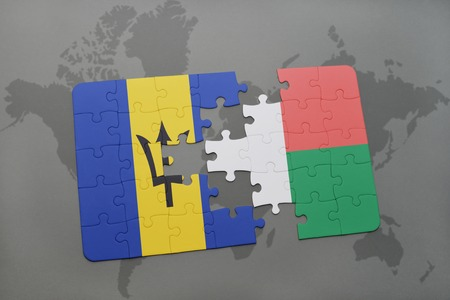 puzzle with the national flag of barbados and madagascar on a world map background. 3D illustration Stock Photo