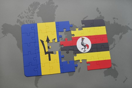 puzzle with the national flag of barbados and uganda on a world map background. 3D illustration