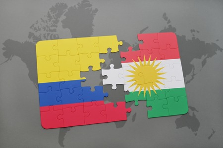 puzzle with the national flag of colombia and kurdistan on a world map background. 3D illustration Stock Photo
