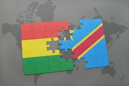 puzzle with the national flag of bolivia and democratic republic of the congo on a world map background. 3D illustration Banco de Imagens