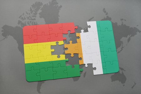 puzzle with the national flag of bolivia and cote divoire on a world map background. 3D illustration Imagens - 75998929