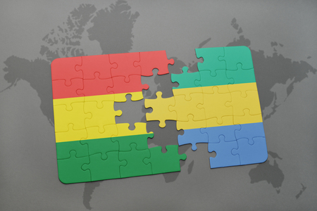 puzzle with the national flag of bolivia and gabon on a world map background. 3D illustration