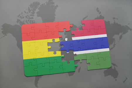 puzzle with the national flag of bolivia and gambia on a world map background. 3D illustration