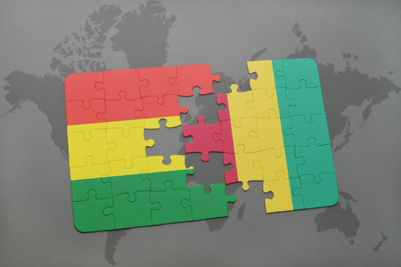 puzzle with the national flag of bolivia and guinea on a world map background. 3D illustration Banco de Imagens